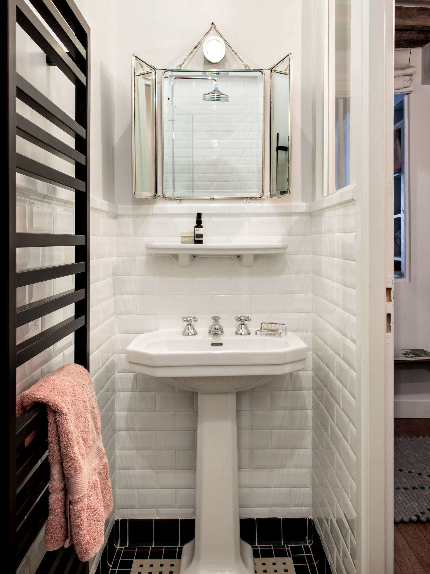 The space formerly occupied by the kitchen was converted into a second metro-tiled bathroom, this one with a towel warmer and shower. To see the apartment in its previous incarnation, go to The Socialite Family.