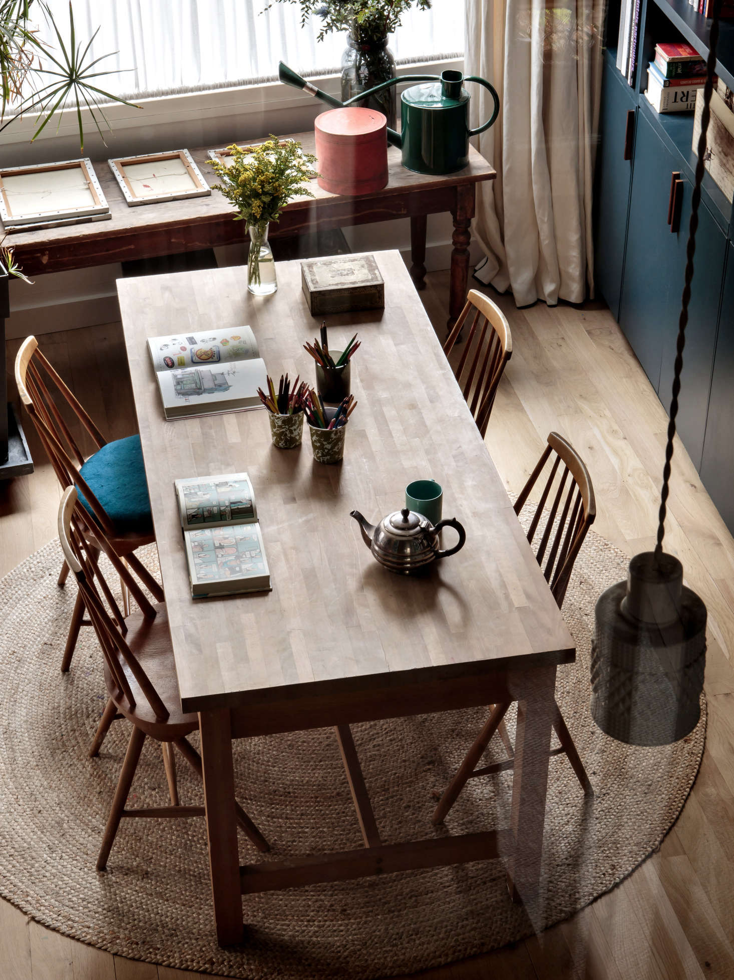The table is an old Habitat design paired with chairs from Selency, a European digital marketplace specializing in vintage Scandinavian furniture. The Fancy Tall Pendant Lights are from Kathleen Hills&#8