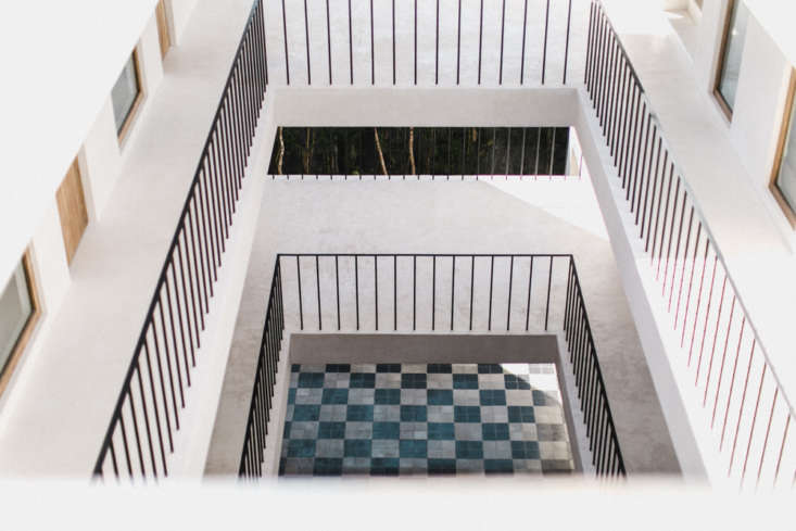 the view from the top floor to the checkerboard tiles on the ground floor. 13