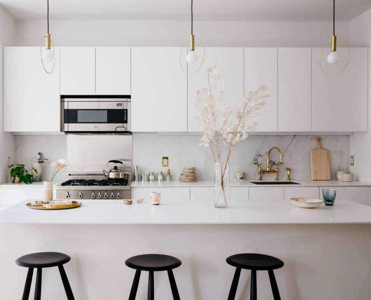 The owners of this kitchen designed it themselves and opted for a Calacatta marble backsplash. For the entire house tour, seeBefore & After: A French-Inflected Townhouse Renovation in Williamsburg, Brooklyn. Photography byBrian Ferryfor Remodelista; styling byAlexa Hotz.