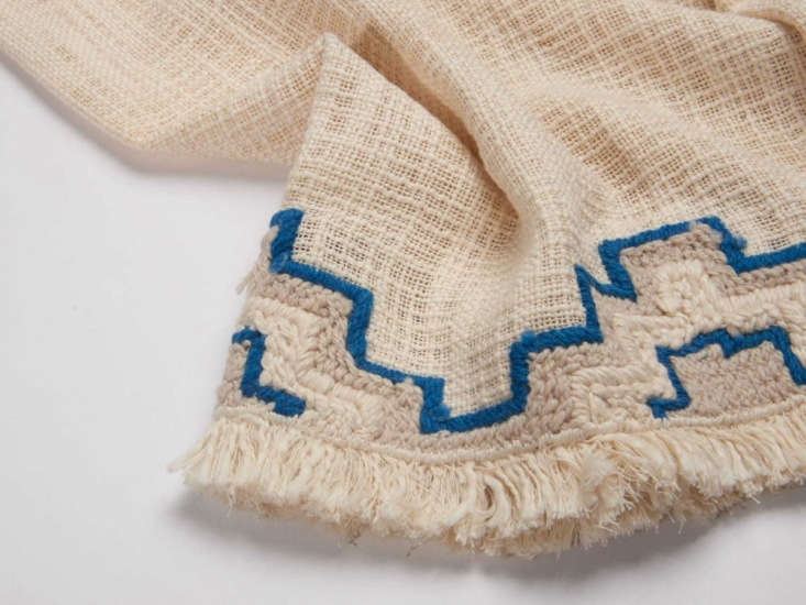The Denon throw is made from 0% khadi cotton, a cloth woven using traditional techniques in India; $loading=