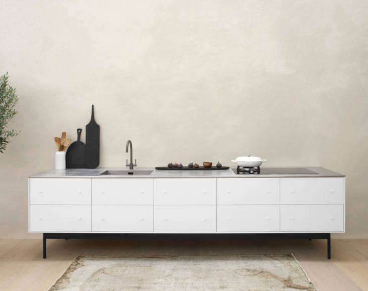 The Broad is a generous freestanding kitchen element made with white pigmented laquer, natural oak interior with deep dovetailed drawers, a stainless steel work surface with integrated sink, tap and mixed fuel hob. The dimensions are 330 x 75 x 90cm and the price, including work surface and appliances, is £,500.