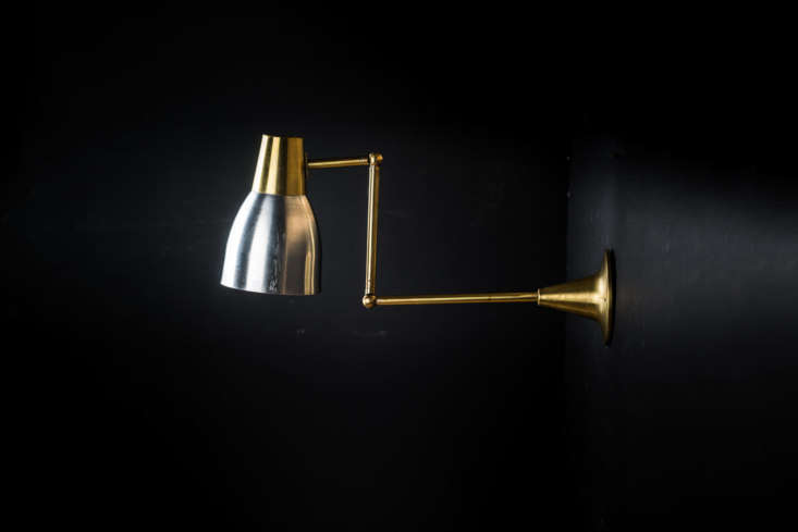 The vintageBrass and Aluminum Wall Chart Lightscame from Felix of Bath; £380 each.