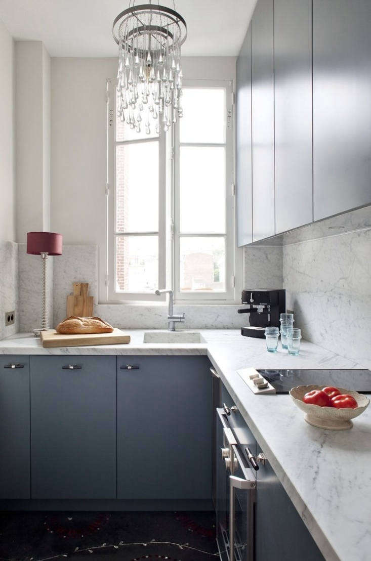 Ochre designer Solenne de la Fouchardiére in Paris used solid marble on both her backsplash and counters. For more, seeSteal This Look: A Minimalist Glam Kitchen in Paris.