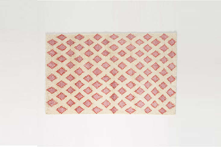 thehand knotted alia rug is made of cotton and wool with a pink diamond pat 9