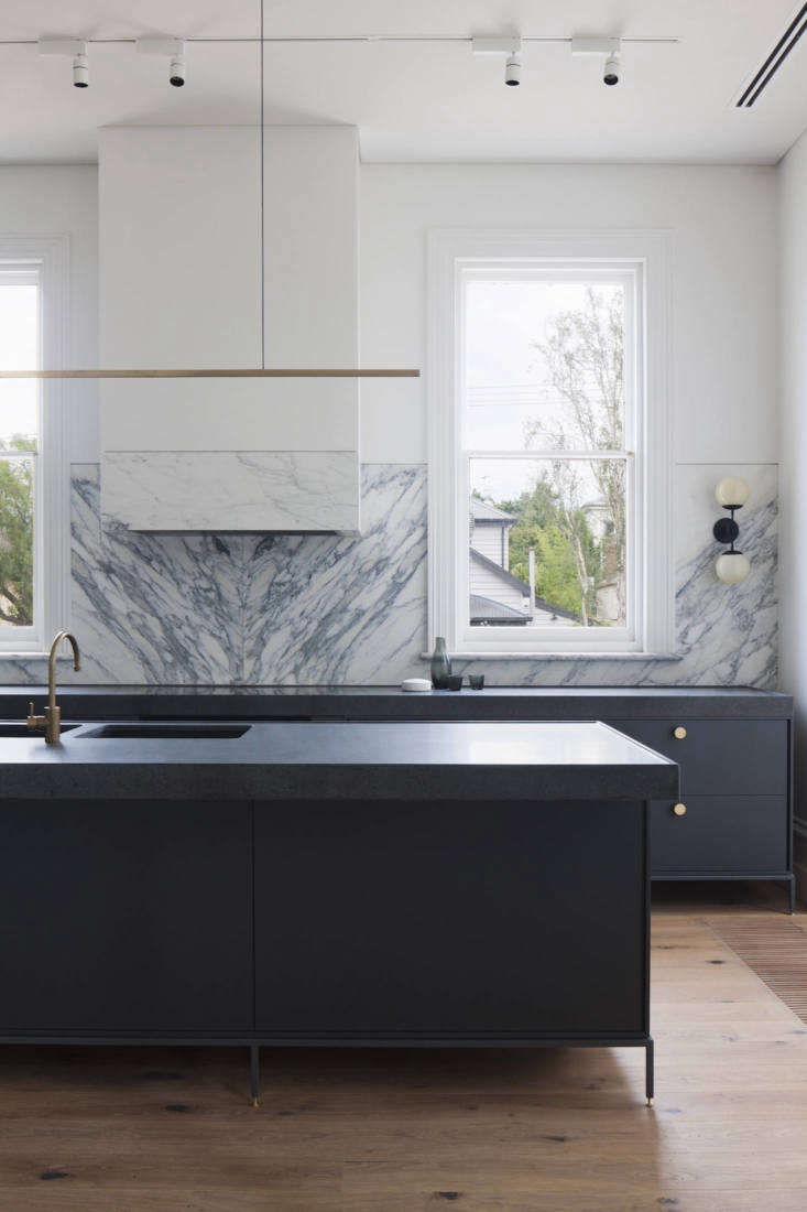 Melbourne-based design firm Hecker Guthrie installed a dramatic marble backsplash in a Scandi-inspired home. For more, seeA Melbourne Victorian's Contemporary Overhaul by Hecker Guthrie.Photography byShannon McGrath, courtesy of Hecker Guthrie.