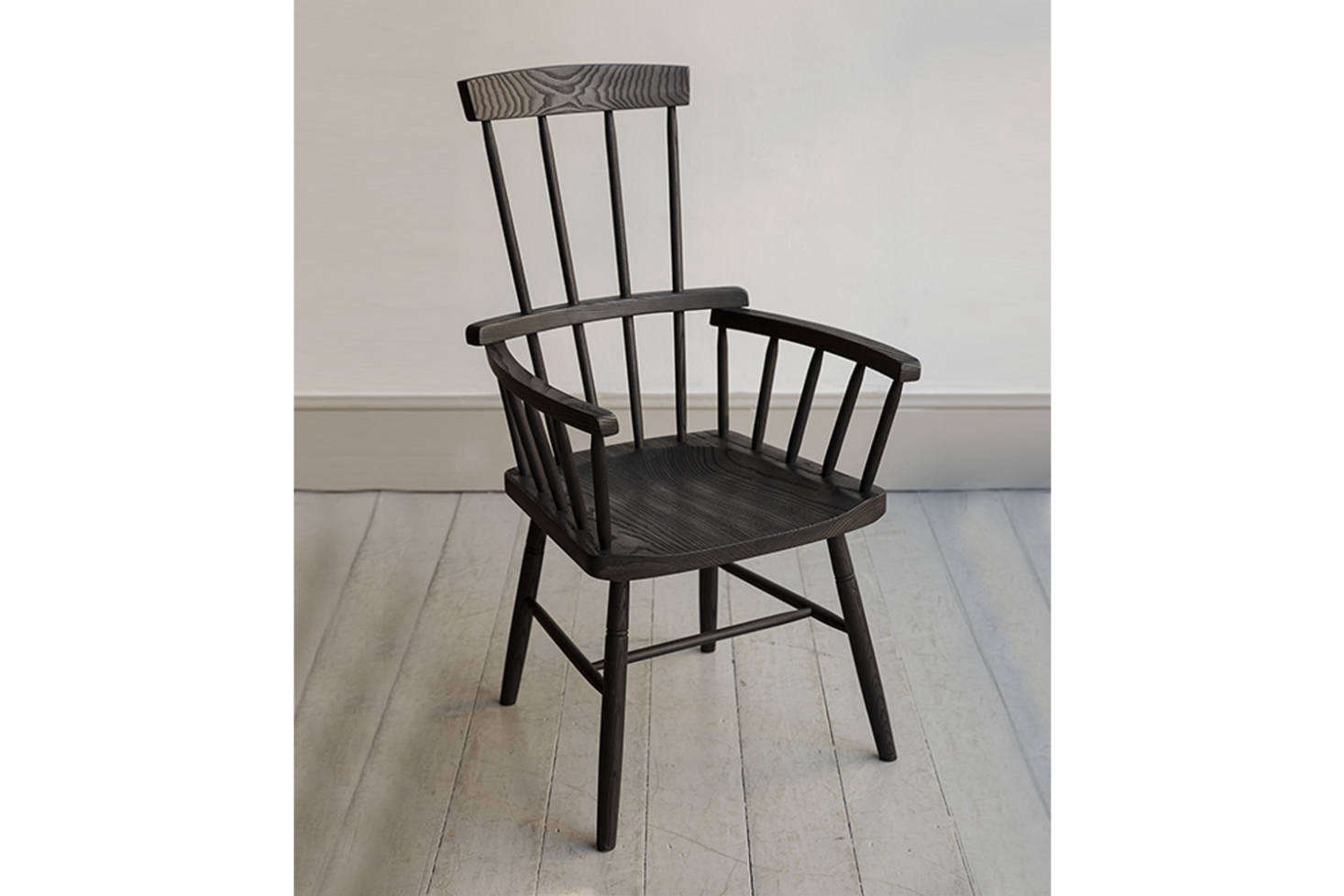 Similar to the antique Windsor style chair is the Howe Charred Comb Back Windsor Chair in blackened ash.Contact for price and ordering information. For more ideas see our post Easy Pieces: The Windsor Chair Revisited.