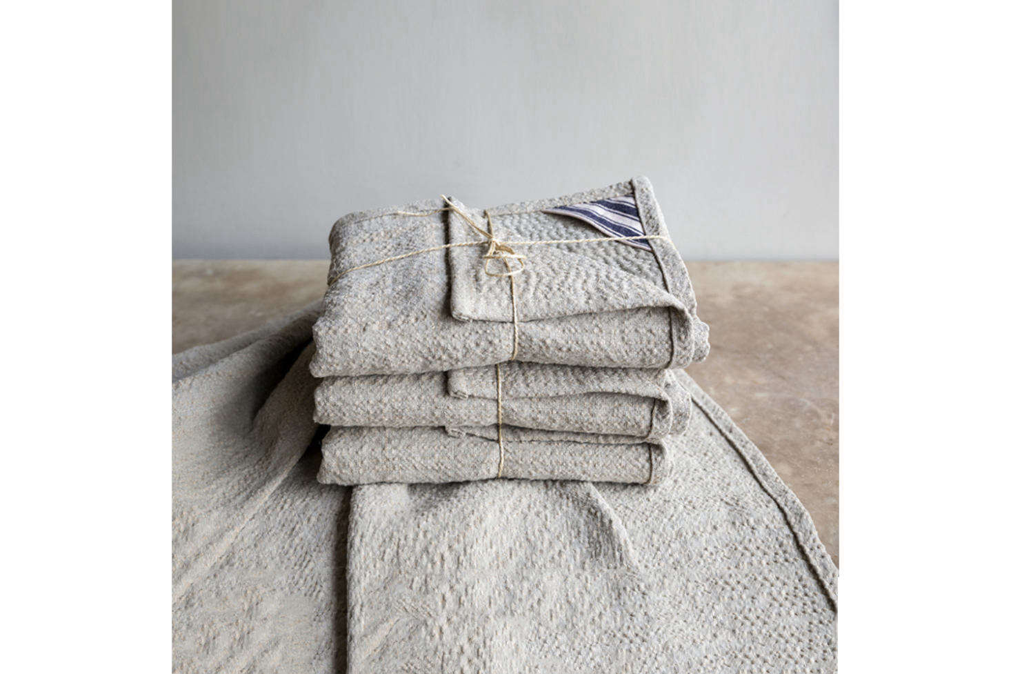 The Hand-Stitched Sashiko Linen Towels are made from a rough linen and jute blend and available at Howe.Contact for price and ordering information.