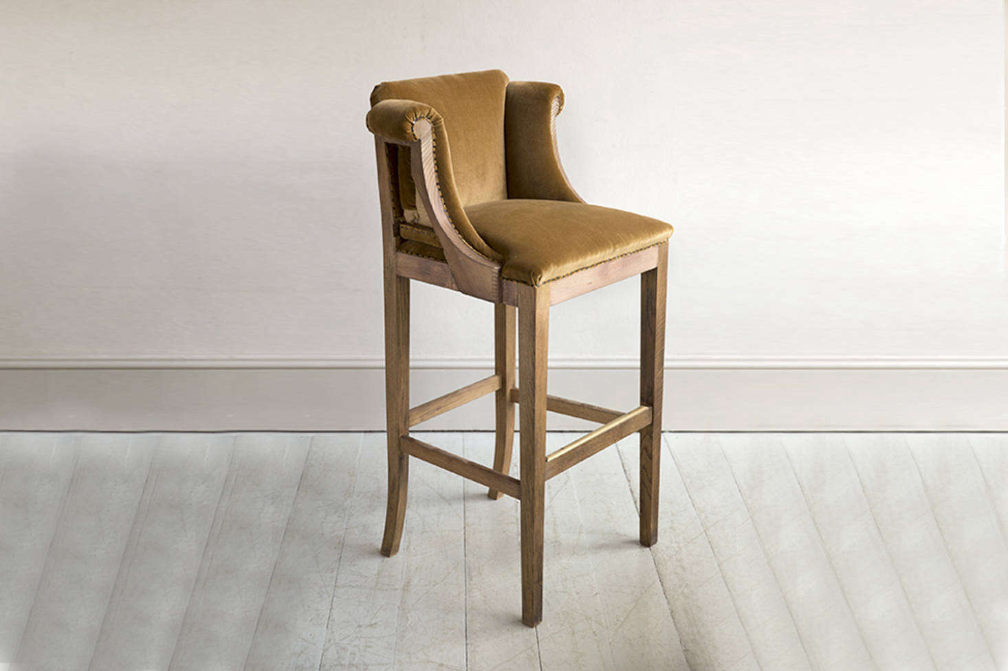 The upholstered barstool near the work island is a Howe design, the Whippet Bar Stool constructed from three different timbers and custom upholstery. Contact for price and ordering information.