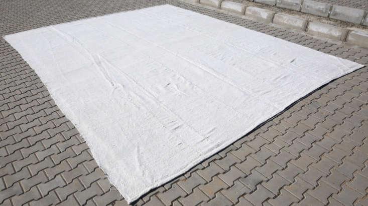 LikeGolubovic, source a vintage kilim rug on Etsy such as this Turkish Kilim Hemp Rug for $