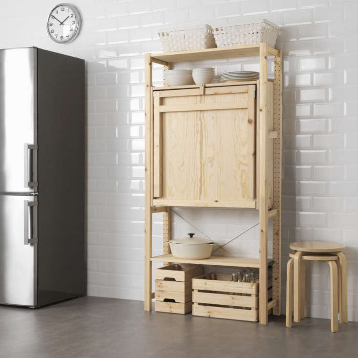 tall and tidy. a small wooden tab locks the table in upright position; spin the 10