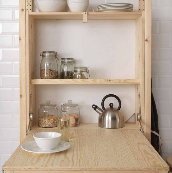 the ivar shelving unit with foldable table can work both as a dining table and  11