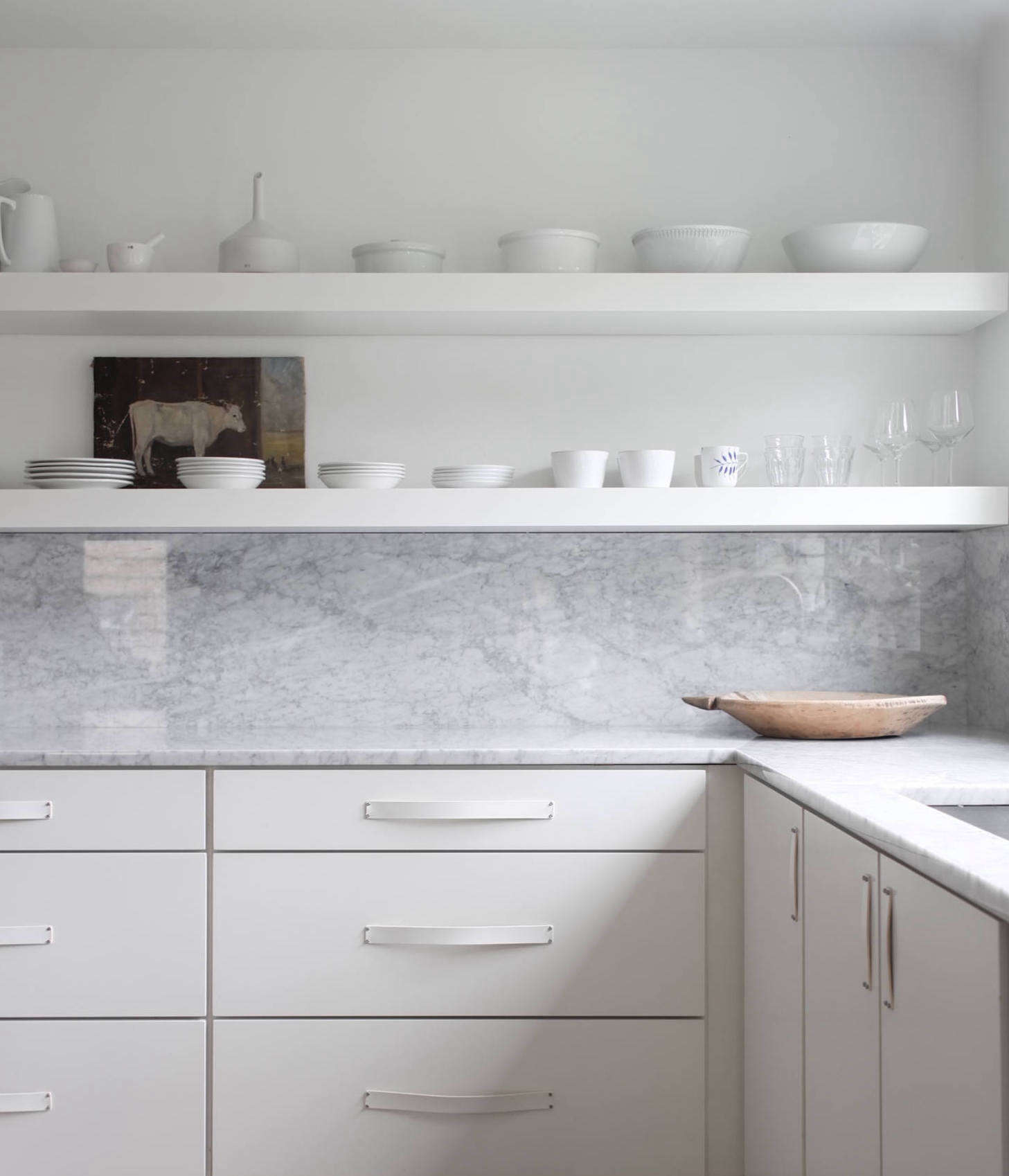 I designed my own kitchen around a solid seamless Carrara marble backsplash and counters. For more on this kitchen (and the rest of the house) seeBefore & After: Remodelista Contributing Editor Izabella Simmons Shares Her Scandi-Inspired Remodel. Photograph by Izabella Simmons.