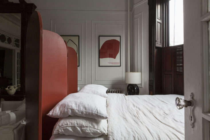 Brooklyn-based shop owner Kai Avant De Leon had a screen custom-built by a local builder. Now it divides her bedroom into two sections—sitting area, and private sleeping area—and hides the bed from sight when guests come over. See more in Bed-Stuy Avant-Garde: Inside the Eclectic Apartment of a Brooklyn Shop Owner On the Rise. Photograph byMel Walbridgefor Remodelista.