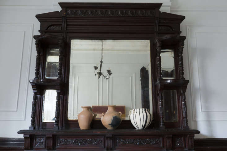 On the mantel are three terra cotta pots, collected on Avent-deLeon&#8