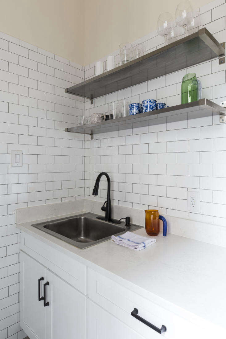 Restaurant supply-style metal shelves, mounted above the new sink. &#8