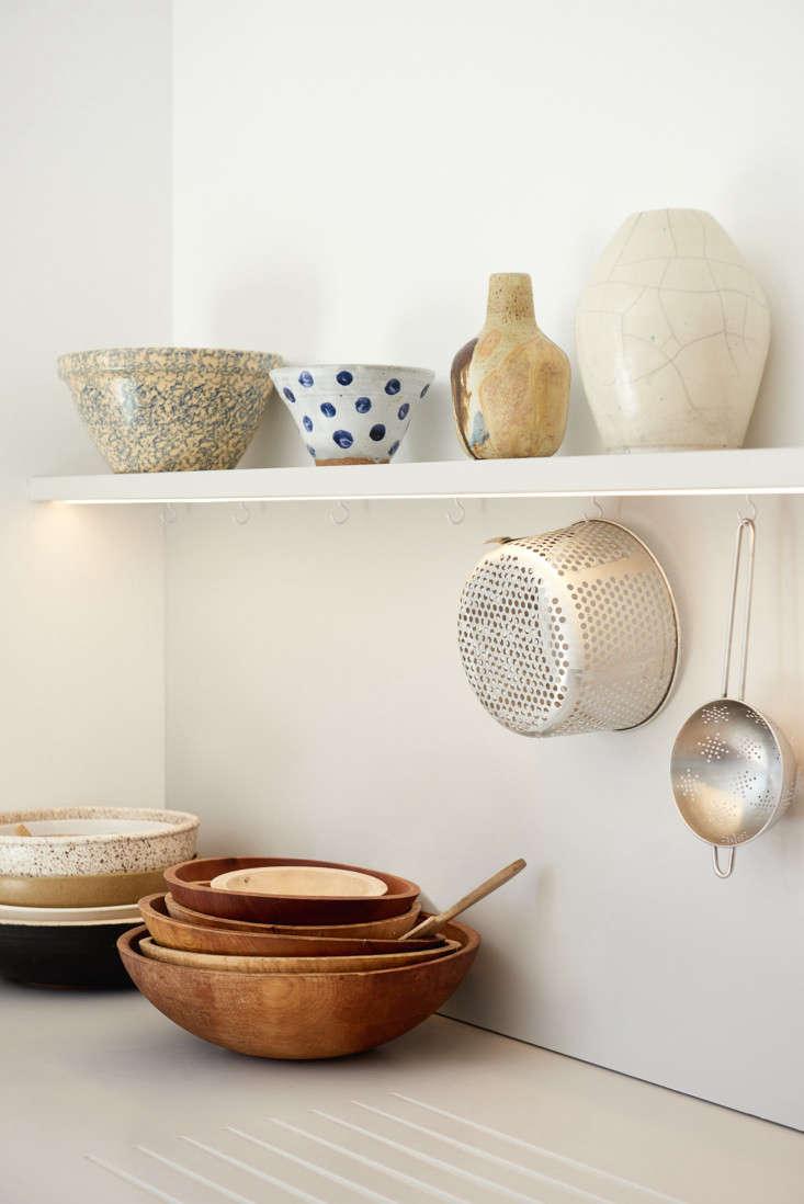 simple hooks under the open shelf provide hanging storage. 17