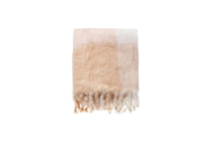 Available at Tiina the Store in Amagansett, New York is the Mohair Blanket Champagne by Lena Rewell; $loading=