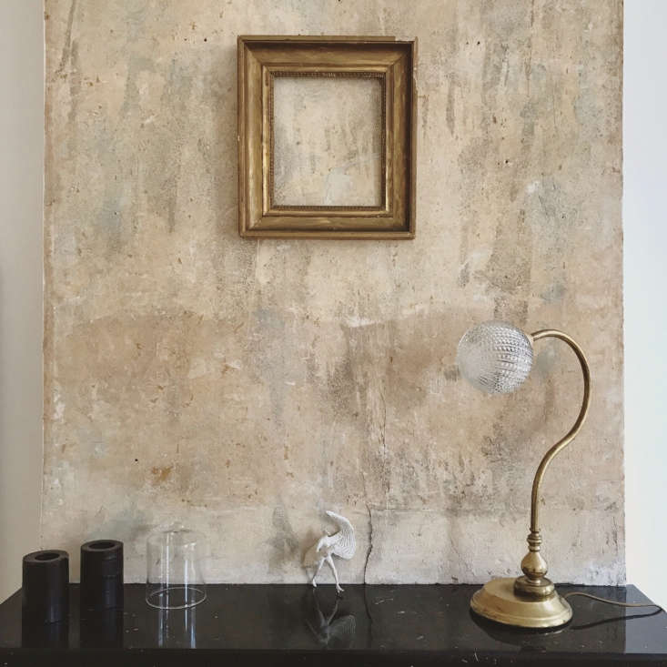 The unfinished wall above the mantel adds, as Brun said of the project, &#8