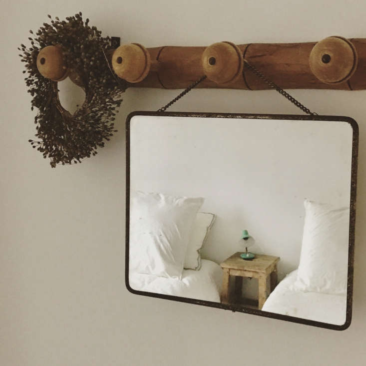 Hanging from a peg: another well-placed mirror.