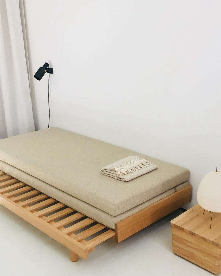 Designed by Martina Bautier Guest Bed is a convertible daybed made of solid oak. The bed slides out from a daybed into a double bed and the top mattress flips over onto the frame; €