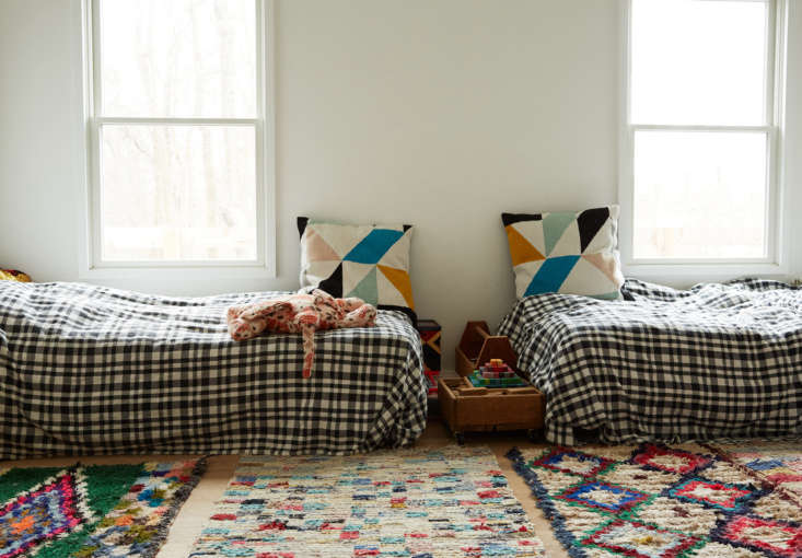 in the kids&#8\2\17; room, toe to toe beds and a patchwork of moroccan bouc 26