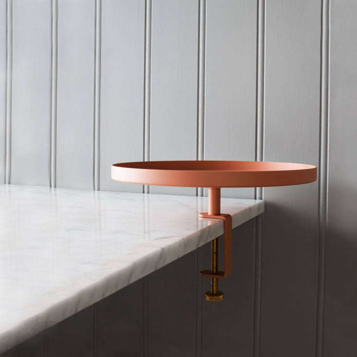 My personal pick: the Navet Clamp Tray, shown in Pink but also available in Graphite, Burgundy, White, and Green, is a good add-on to convert a regular side table into one with a tray; 930 SEK ($0 USD) at Tambur in Sweden.