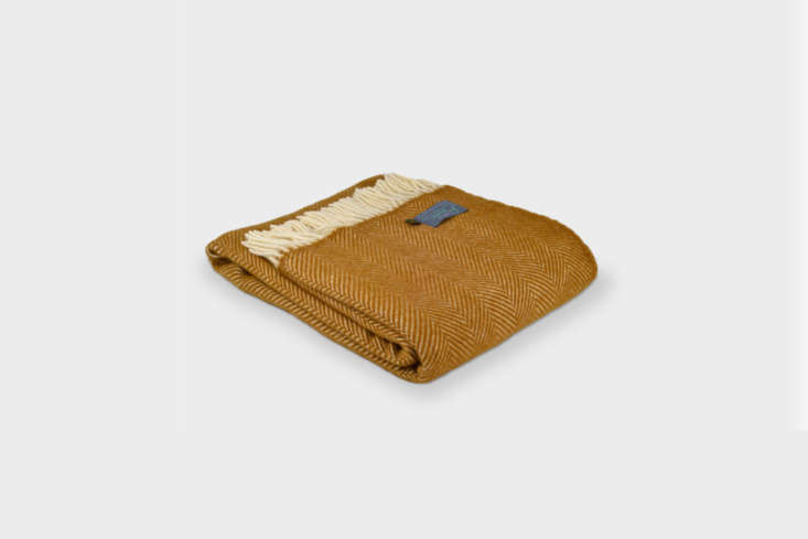 The Mustard Yellow Herringbone Throw is $78.47 at the British Blanket Company.