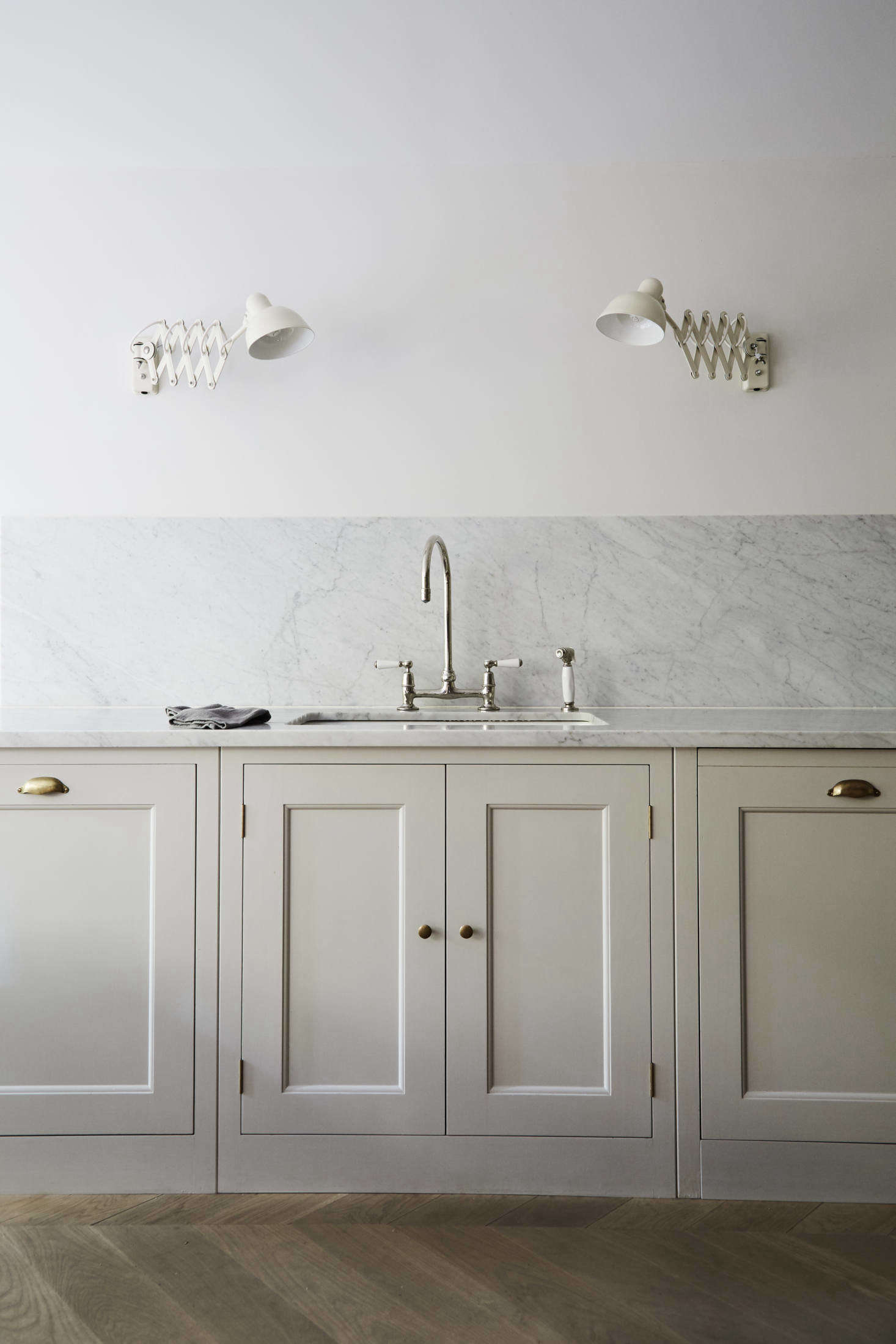 This British inspired kitchen has counters topped with Carrara marble that continue as a backsplash. For more, see Plain English in Brooklyn Heights: A Very Proper Elizabeth Roberts Townhouse Remodel. Photograph byDustin Aksland, courtesy ofElizabeth Roberts Architecture & Design.