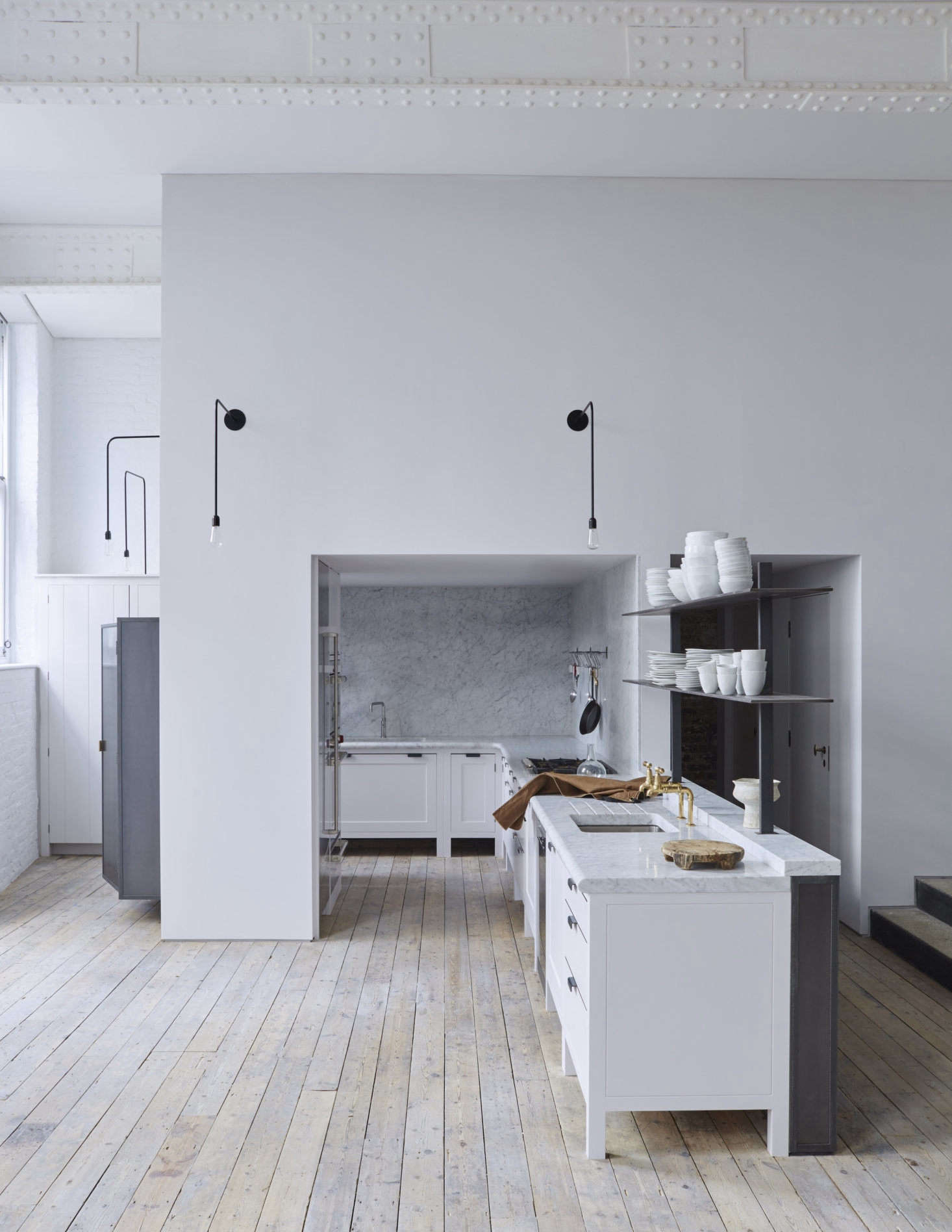 Seth Stein Architectsrevitalized a former schoolhouse in London by adding a Plain English kitchen, and clad two entire walls in marble. Photograph courtesy ofPlain English; see the full kitchen inKitchen of the Week: Plain English Goes Contemporary in a Converted London Schoolhouse.