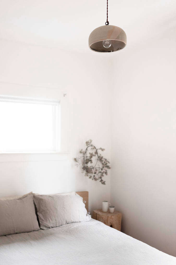 Portlandia Inside the Remodeled Farmhouse of a Cult Favorite Ceramicist The couple&#8\2\17;s quiet bedroom is fitted with an Ikea bed frame and linens from Parachute Home. Note the artfully imperfect wreath above the bed.