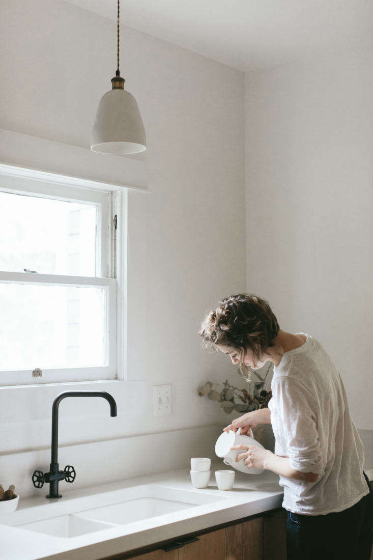 Portlandia Inside the Remodeled Farmhouse of a Cult Favorite Ceramicist Van Raden in her kitchen, with her own ceramic pendant light.