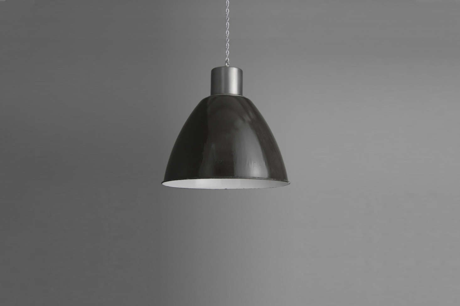 A trio of industrial factory lights over the kitchen island are from vintage industrial lighting dealerSkinflintof Cornwall. Shown here are similar lights from Skinflint, the XL Eastern Bloc Industrial Lights; £540 each.