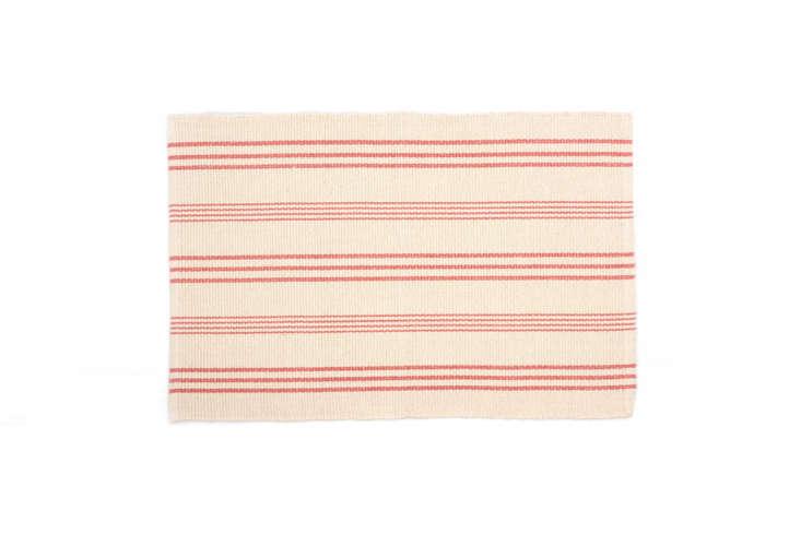 a rug in a more classic stripe: theskona stripe woven rugin a coral hue sta 20