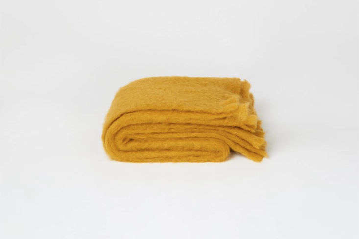 The Toast Mohair Blanket in Warm Ochre also comes in a darker Tobacco color; $5 at Toast in the UK.