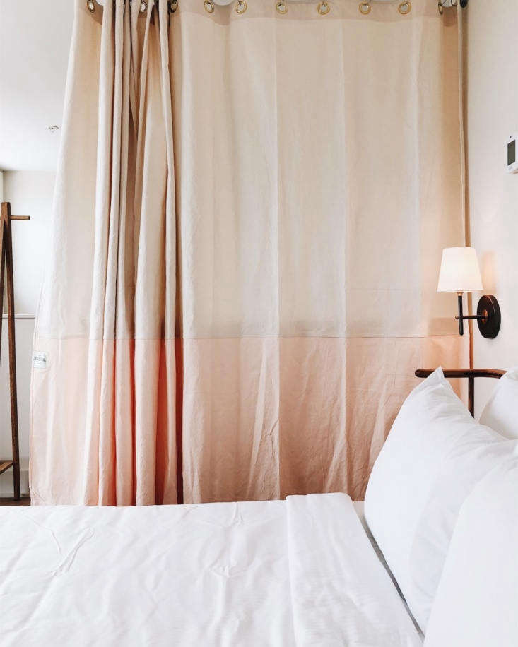 Custom shower curtains from Quiet Town add color and texture to a bedroom area.
