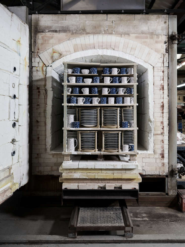 a batch of glazed wares heads into the kiln for their third and final firing. 14
