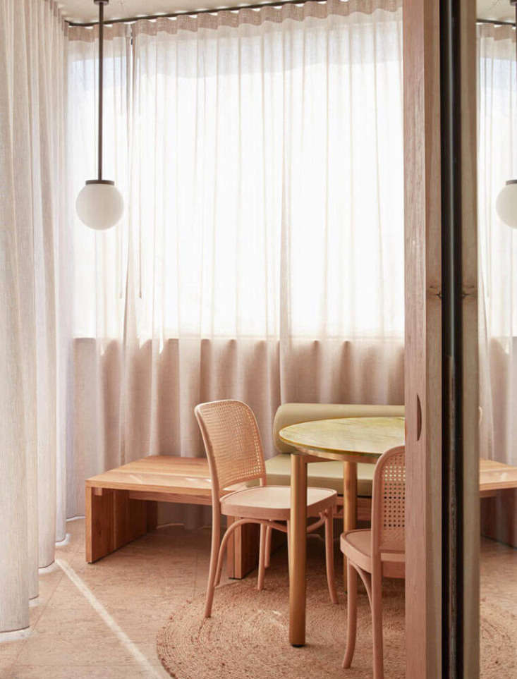 Sheer curtains throughout the hotel—hung floor to ceiling, along windows and walls alike—soften the hard angles and materials, as do circular rugs. (For another project that uses sheer panels to great effect, seeA Luminous, Euro-Style Row House in Washington, DC, Courtesy of Studio Oink.)