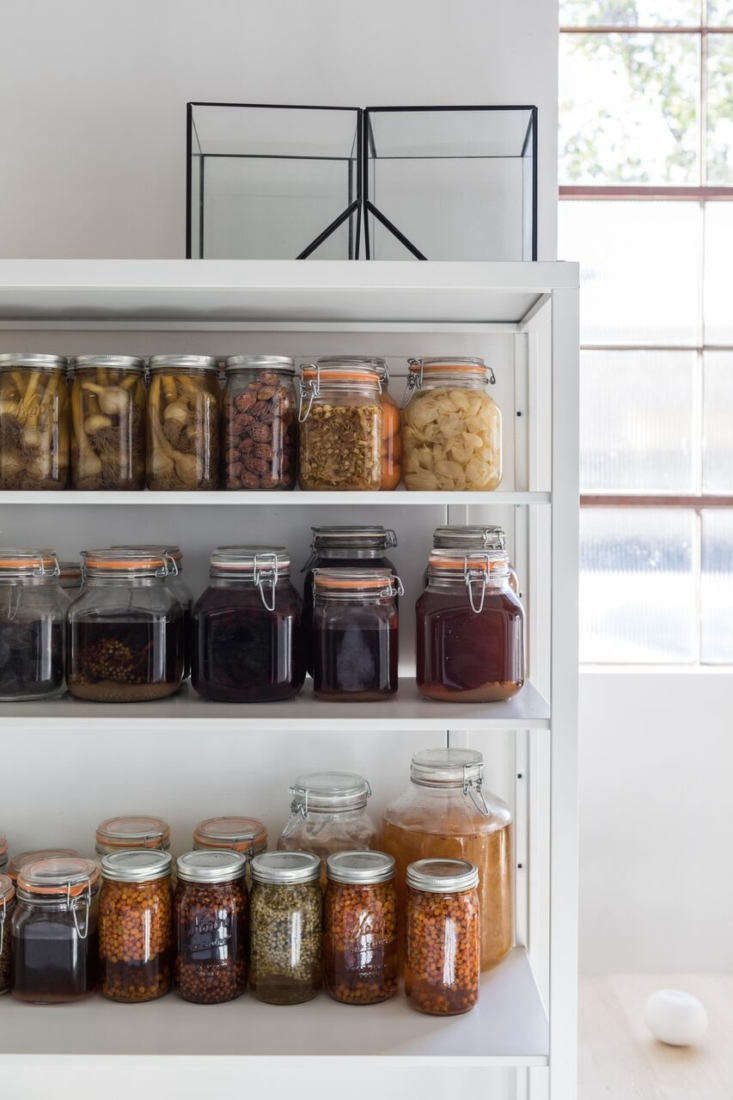 mason jars filled withpreserved botanical ingredients add a dash of color to  11