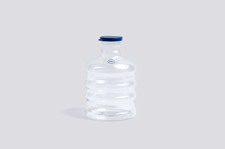 The Blue Lid Carafe, made of handblown glass, is $