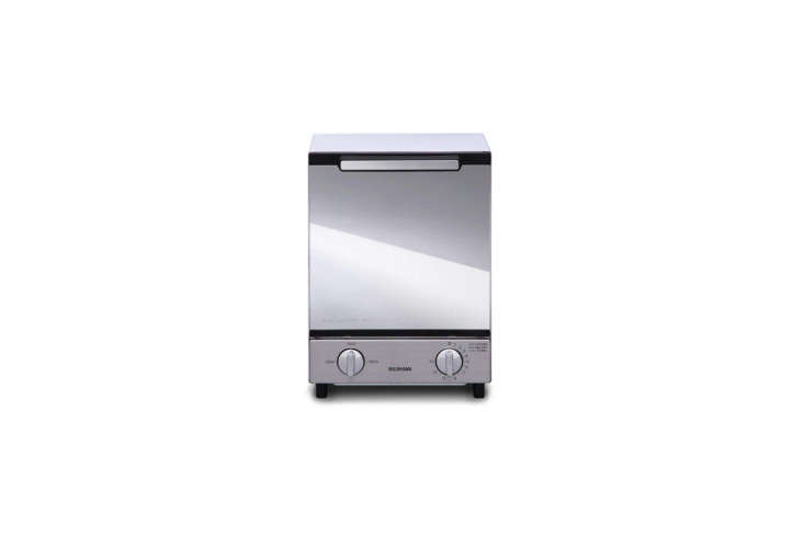 The Iris Ohyama Mirror Oven Toaster Vertical Type is made of powder coated steel with a mirrored glass door. It measures about 7.5 inches wide; $98.39 on Amazon. (Power supply AC0 V 50/60 Hz.) It can also be sourced through Sano Shop out of Japan.