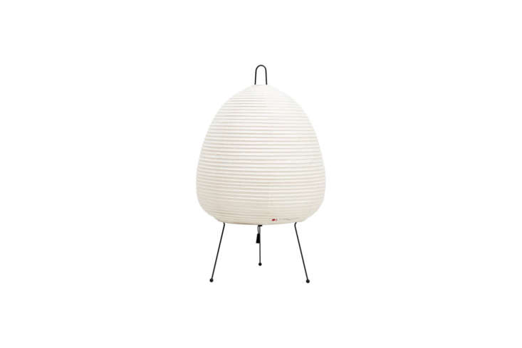 Noguchi light sculptures feature handmade washi paper and bamboo ribbing, supported by a metal frame. The Akari Table Light Model loading=