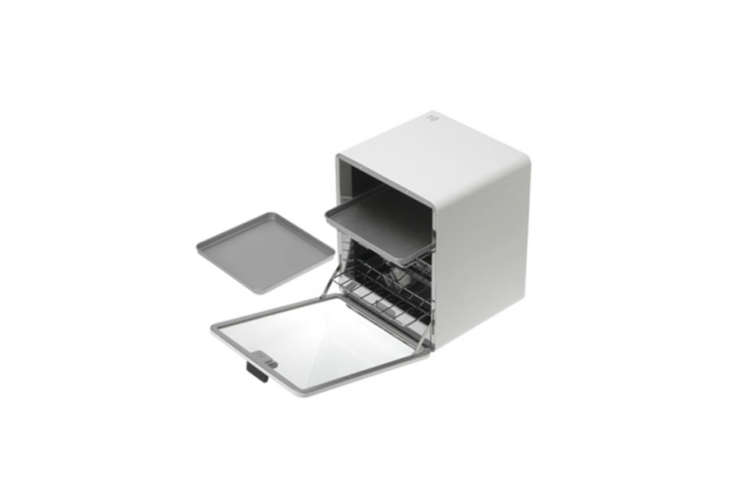 While difficult to source, thePlus Minus Zero Vertical Toaster Oven, from Naoto Fukasawa, mesaures 9.5 inches wide and loading=