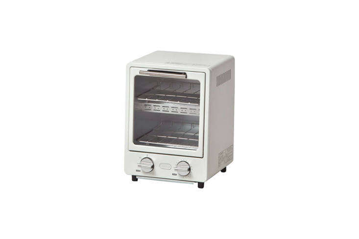 The Radonna Oven Toaster comes in three colors (Ash White, shown; Blue; and Shell Pink) and has a slanted front/trapezoid shape. It measures 9.5 inches wide by about  inches high for $3.73 from sellers on Amazon. It can also be sourced through Sano Shopout of Japan. (Power supply AC0 V 50/60 Hz.)