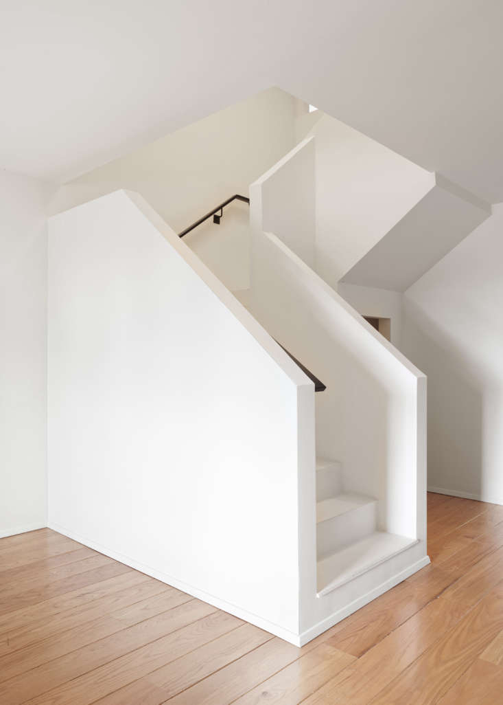 Kristen replaced a central cluster of closets with an architectural stair to the lower level. &#8