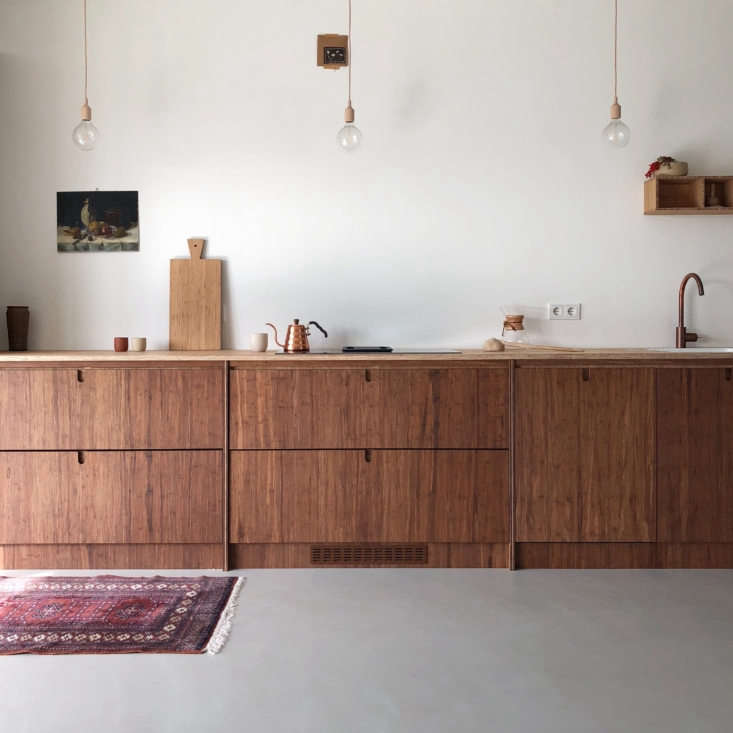 The stained bamboo cabinets are topped with a bamboo counter in Ask og Eng&#8
