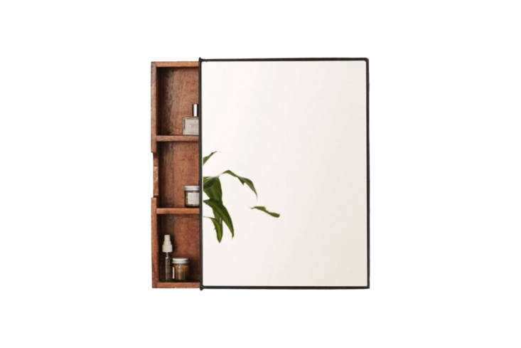 Even Urban Outfitters makes one: the small (-by--inch) Plymouth Sliding Storage Mirror in mango wood with an iron framed glass front for $9 at Urban Outfitters.
