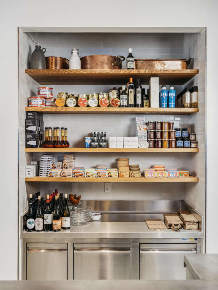 Inset into the pantry alcove is pale grey glossy tile from Heath Ceramics. Photograph by Christopher Stark.