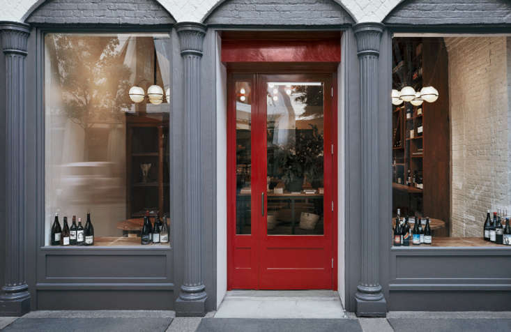 The exterior of Verjus (at 5 Washington Street) is painted with Fine Paints of Europe 75(gray) and the door isFine Paints of Europe 70(burgundy/red). The light fixtures inside are theFive Globes Pendant Lights by Gino Sarfatti. Photograph by Tolleson.
