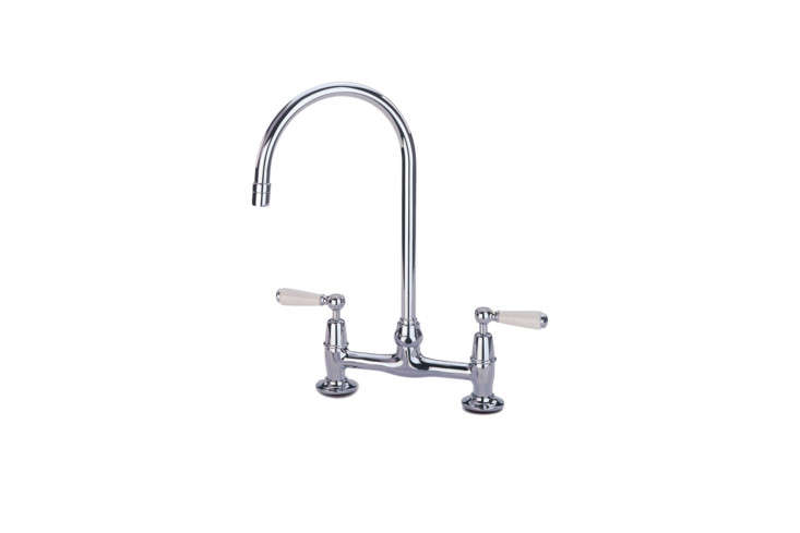 With porcelain white handles, the Barber Wilsons Bridgemaster 30 Kitchen Mixer Bridge Faucet with Side Spray starts at $